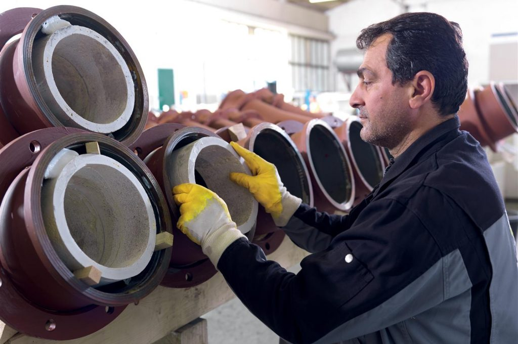 WEAR PROTECTED PIPING SYSTEMS 1
